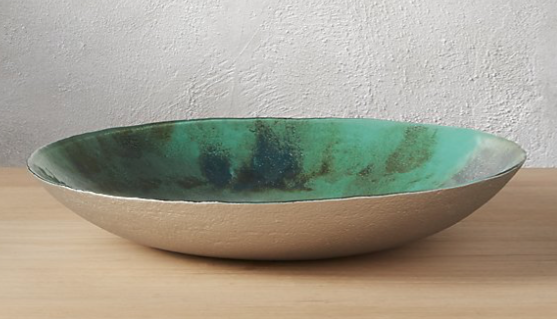 Bowls--so versatile! Use as a catch all on your entry table, on your dining table, on top of a stack of coffee table books, etc. And this shot of green is just perfection. Buy it  here .