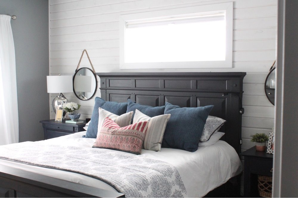 White duvet with pretty accent pillows makes for a relaxed, clean feel.