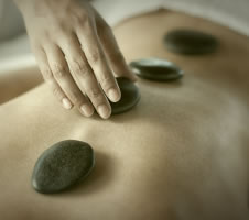 stock-photo-18206965-hot-stone-massage-therapy-cropped.jpg