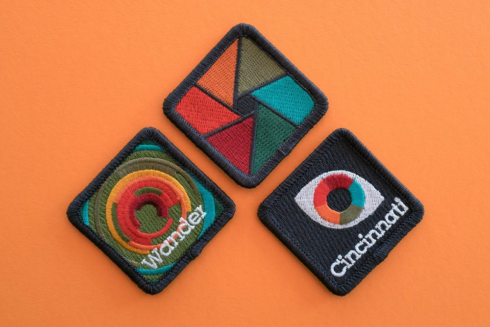Participants earn patches for each of the major categories: Photography, Neighborhood and People.   Design & Photo by Chris Glass