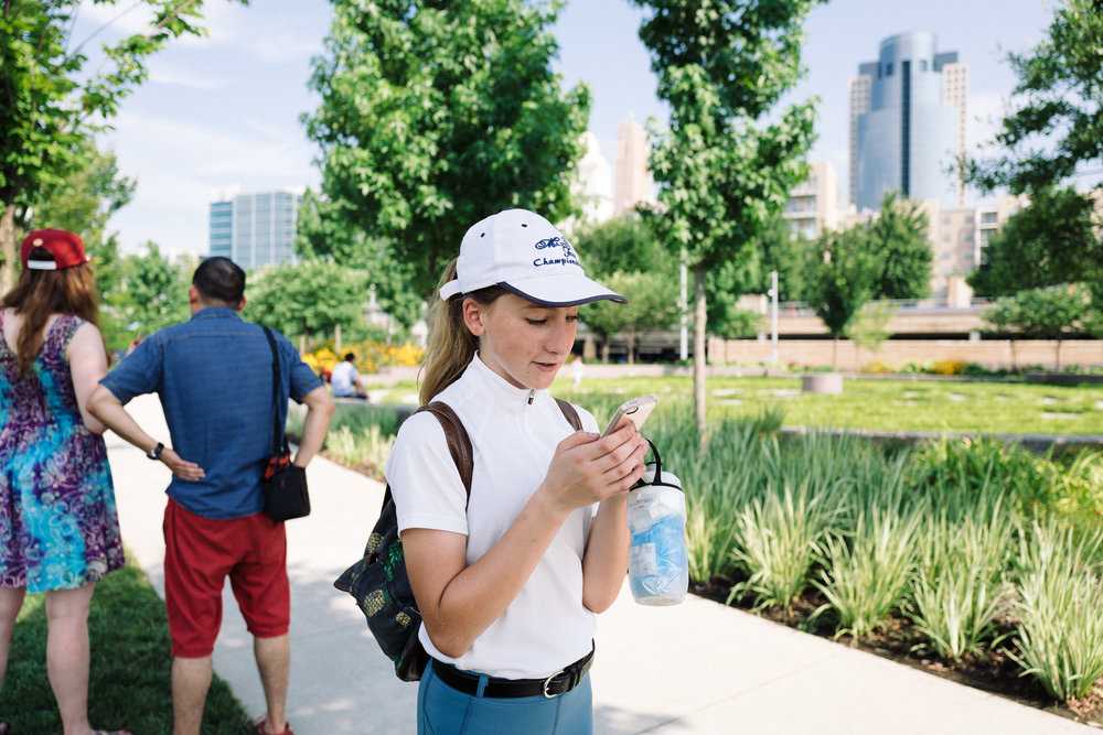 Neko Duvall takes a photo with her mobile phone during a Photowalk along Smale Riverfront Park