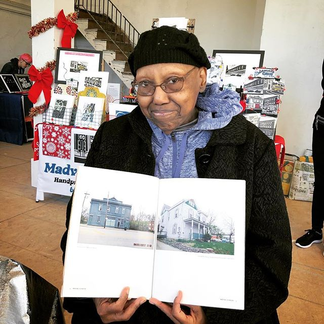 Maxine just stopped by our table at The Madisonville Holiday Pop-Up and picked up her neighborhood edition. Here she is showing off her photos in the book!
