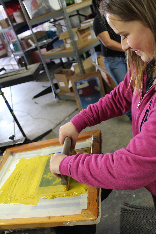 Amanda printing with a smile.jpg