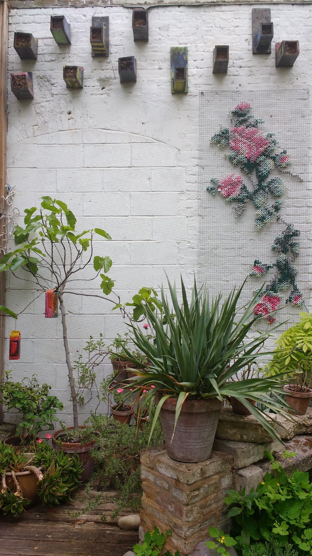 A home for birds, bees and artists alike: cross stitch, figs, geraniums and insect hotels