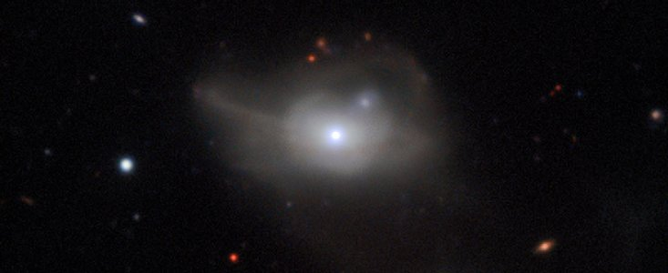 "In 1984, Markarian 1018 became the first-known ""changing look"" quasar, converting from a faint, narrow-lined Seyfert 2 to a bright Seyfert 1. The Close AGN Reference Survey (CARS) has now discovered that the galaxy has recently reverted  back  to a Seyfert 2, retreating to the shadows once more. It is the first such object to go ""there and back again""."