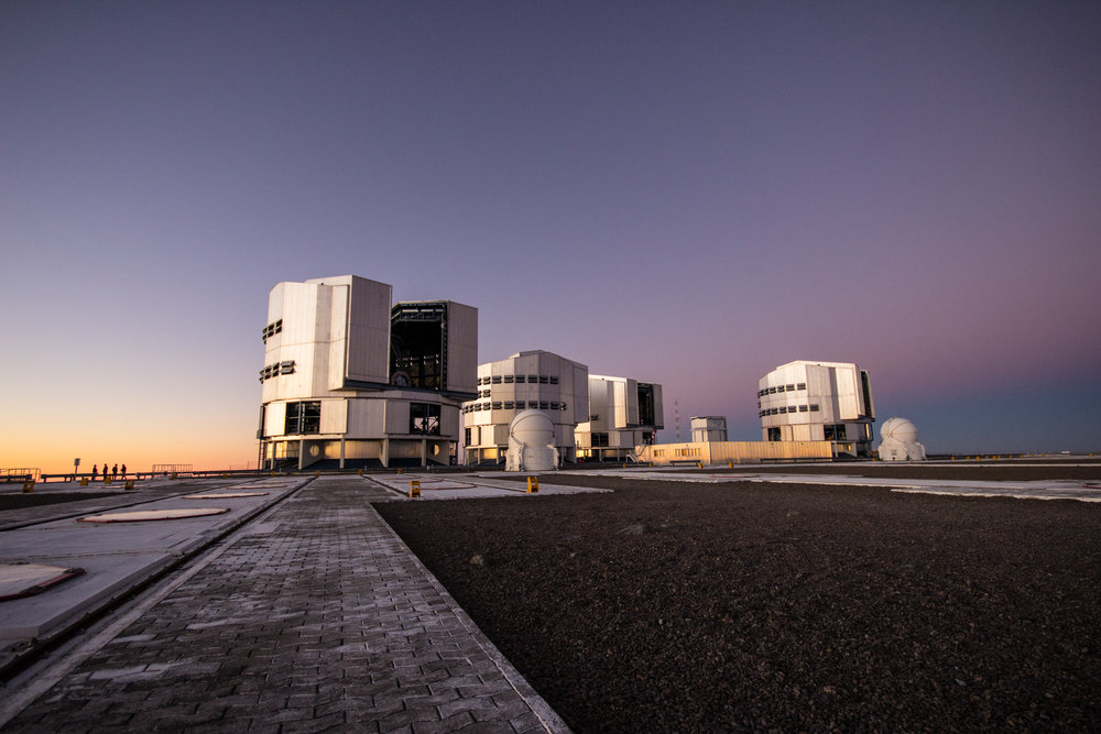 The Very Large Telescope. The large structures house the four eight-meter Unit Telescopes. I controlled the second from the left, (UT2 / Kueyen). The smaller domes are Auxiliary Telescopes, forming part of the VLT Interferometer.  © Dr. Grant Tremblay