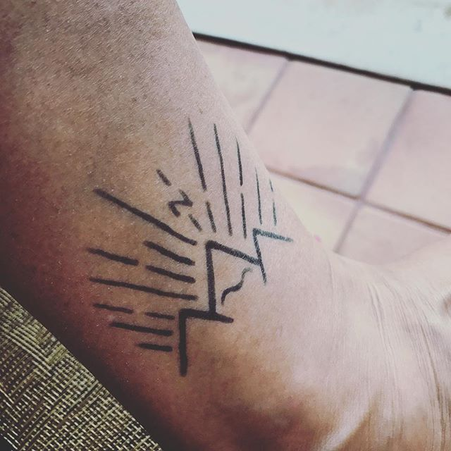 We love seeing our logos in the flesh... this time quite literally! #happyclients #itjustclickeddesign #logodesign #branding #logotattoo @hiptravelmama