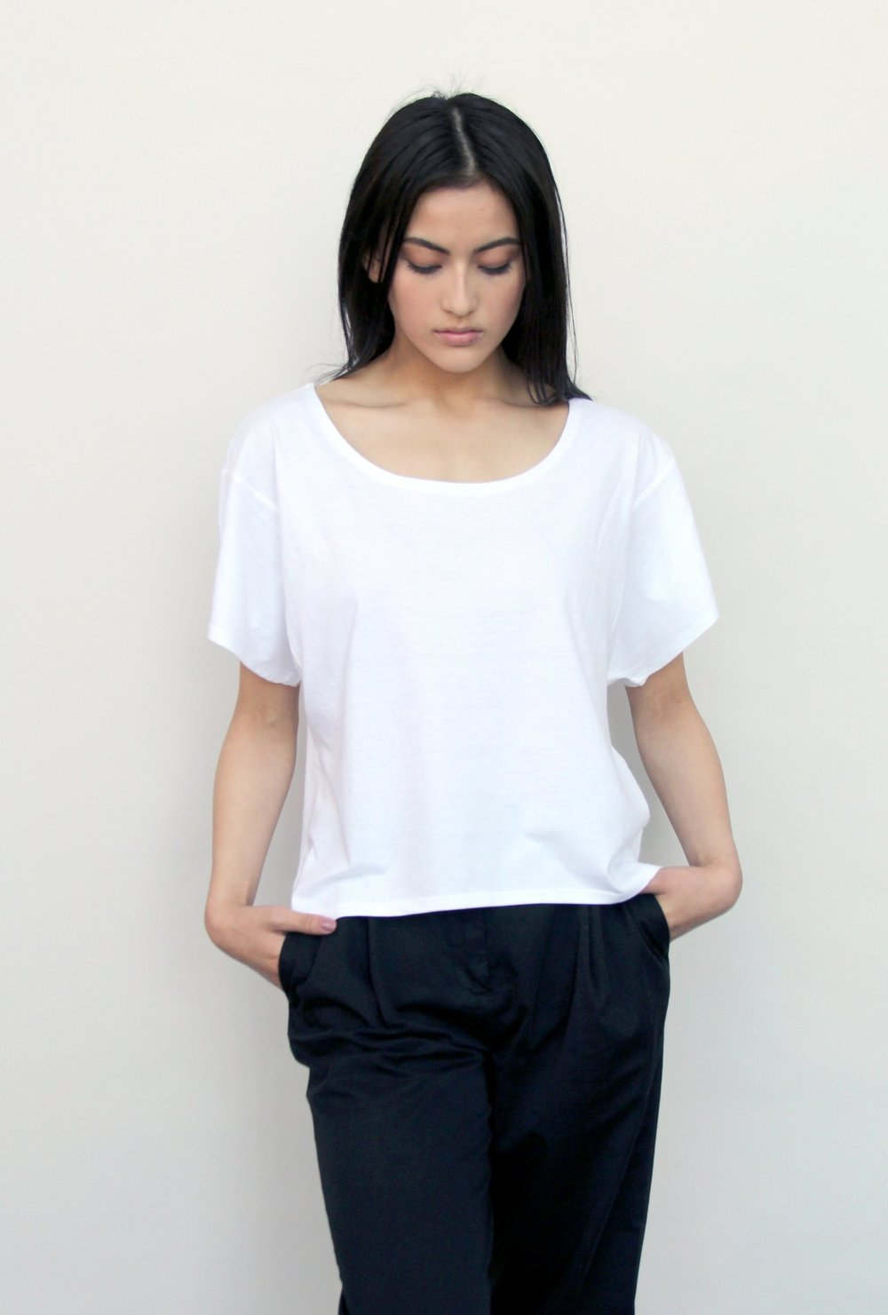 Women's Boxy Tee - White $32  Make a statement with this more-than-simple white tee. This is a completely sustainable tee-shirt, packed with the elements of carbon neutrality, fair trade, and organic materials. Thoughtfully made by artisans in Kenya.