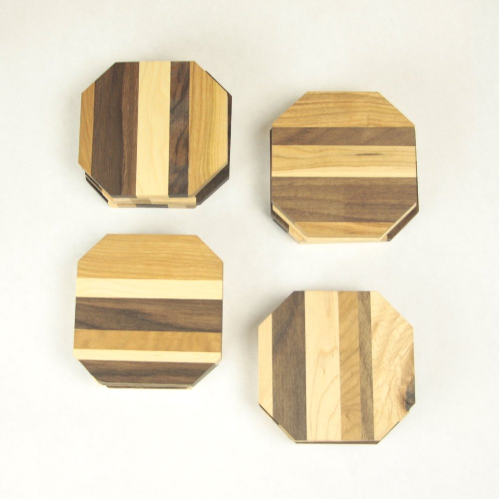 Wooden Coasters $4 each or $12 for set of 4  Gift the gift of uniqueness with these wooden coasters created by hand from randomized patterns of maple, cherry, and walnut woods. Its the best way to sip coffee together (or some wine - let's be real).