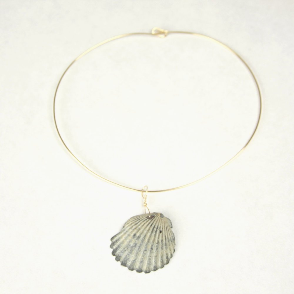 Hamptons Sea Shell Necklace $28  How sweet would it be to walk down the beach together and watch the sunset? Perhaps this piece can bring you back to those memories while she wears it out on your date nights together. A perfect gift for the perfect lady.