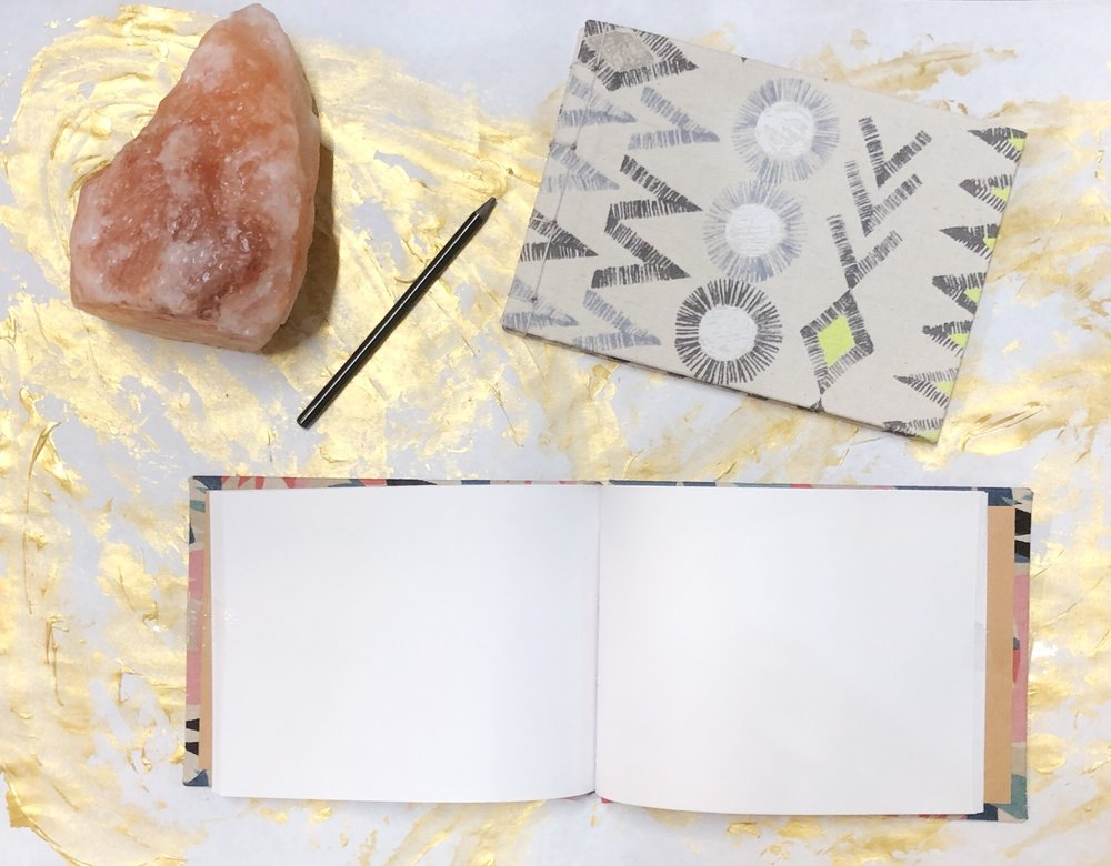 Shapes Scene Handmade Journal $22  Write it down. A journal for remembering things. Perfect for bullet journaling or getting that creative writing on. Made from Recycled Paper, 100% Japanese Cotton, acid free binder board, and hemp cord.
