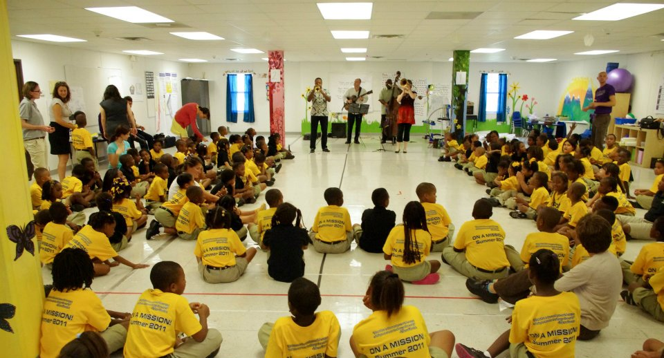 Leroy Jones, Todd Duke, Mitchell Player and Katja Toivola perform for local students.