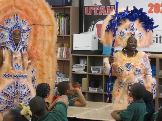 "David Montana and Ausettua Amor Amenkum in a presentation of the ""Mardi Gras Indian Experience"" to local students."