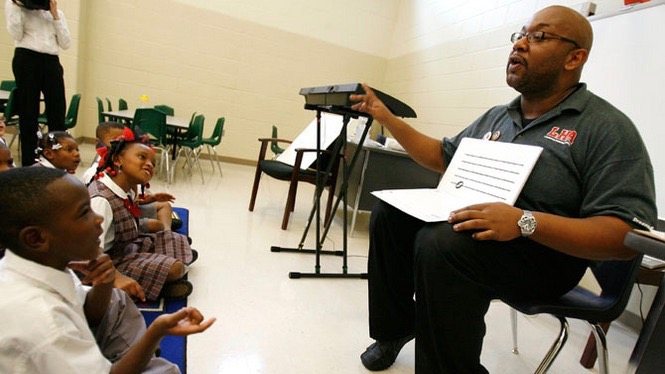 Artist corps Fellow david pulphus leads young students in music theory instruction during his first year of teaching. (2010)