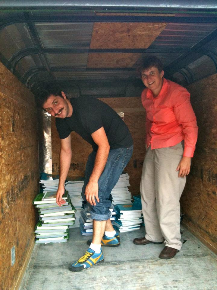 ARTIST CORPS Alum Zack Feinberg and Education Director Dr. BETH HAYES load up music curricula for distribution to new orleans music teachers. special thanks to  the revivalists  for use of the band's trailer ON that hot august day! (2011)