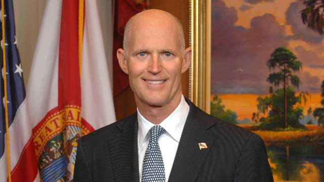 Gov-Rick-Scott-w-fl-flag.jpg