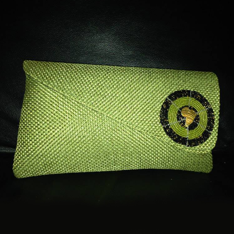 Clutch   $30.00 (Cash/Cheque) | $38.25 (Credit)  This simple green clutch has a beautiful woven design and features a beautiful beaded design on the front flap.