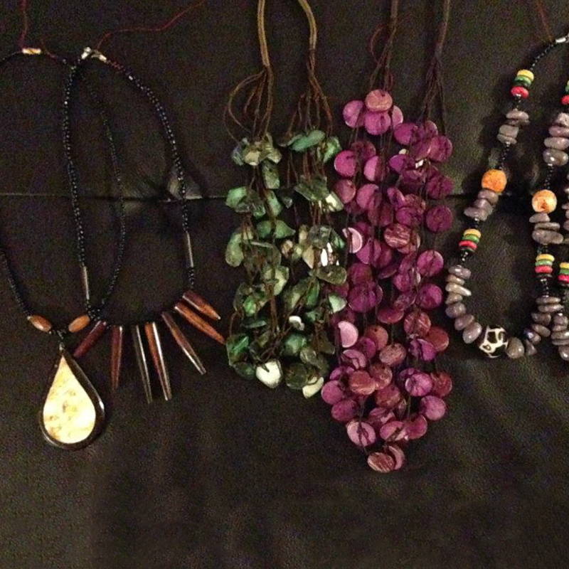 Necklaces   $15.00 (Cash/Cheque) | $19.12 (Credit)   Assorted handcrafted necklaces made of traditional Kenyan materials. Each necklace has its own unique design and colours.
