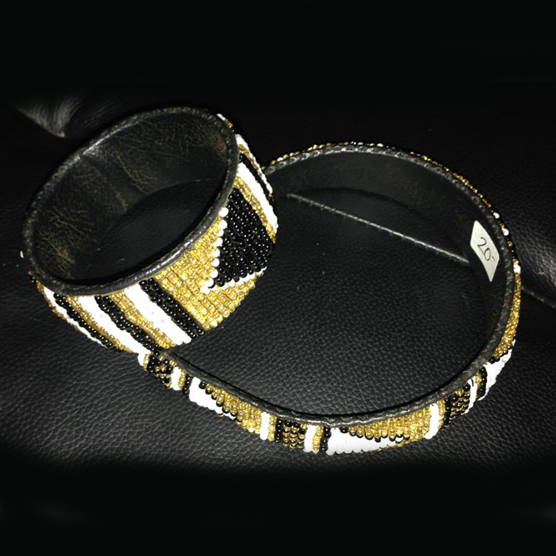 Headband & Bracelet Set   $20.00 (Cash/Cheque) | $25.50 (Credit)  This headband and bracelet set are handcrafted with a beautiful black, gold and white beaded design.
