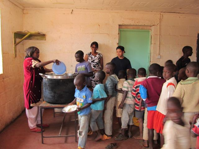 Mama Tunza serving up a late lunch for the children.