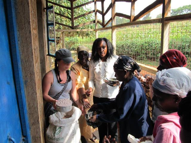 Distributing food and Spirulina to each individual at Kieni Fighter's of HIV/AIDS.