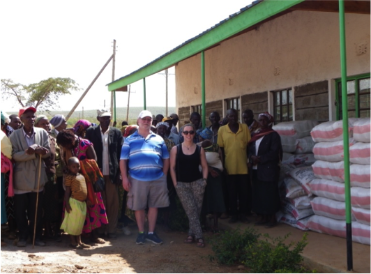 Gil and Cat with families before distribution of seed and fertilizer!