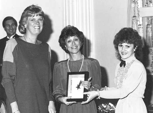 Left to right: Louise Tucker, Partner, and Founder Billie Jo Wanink accept award at first Haworth dealer meeting in 1981