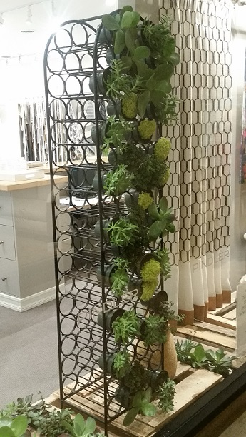 Here's an easy, small scale way to incorporate greenery into your workspace. Faux greenery walls or focal points are a great, low-maintenance tool.