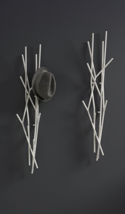 I really like these   Whisp coat racks by Davis Furniture.  Available in a wall-mounted version as well as a freestanding floor rack, it almost functions as a sculptural piece when not in use.