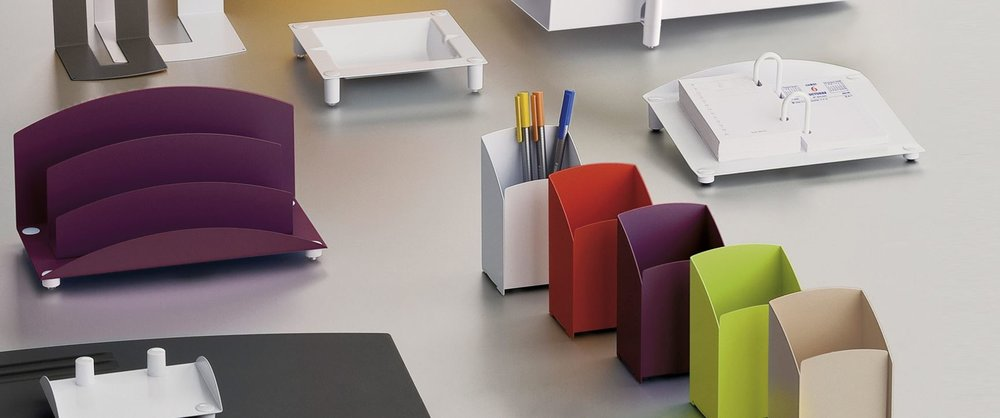 Accessories can be everything. Magnuson Group offers desk accessories from their Axiane line, which includes a violet finish option.