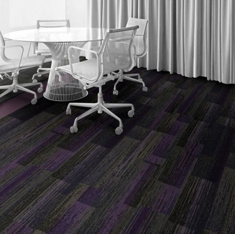 Interface Carpet is also showing love for this unique color. The Aerial Collection includes a more subtle shade of the violet with the Smoke/Iris plank tile. Mixed with the Aerial Smoke tile and their On the Line Iris tile, gives the ability to create an eye catching carpet layout.
