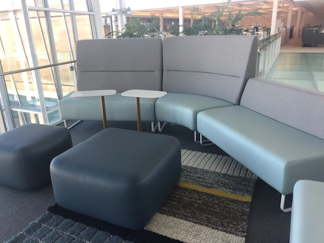 This is Haworth's new lounge seating called Riverbend, Pebble Ottomans, and Pip Tables. This was my first time seeing the product in person! It was very comfortable and elegant, and I personally loved the unique hoop leg bases.