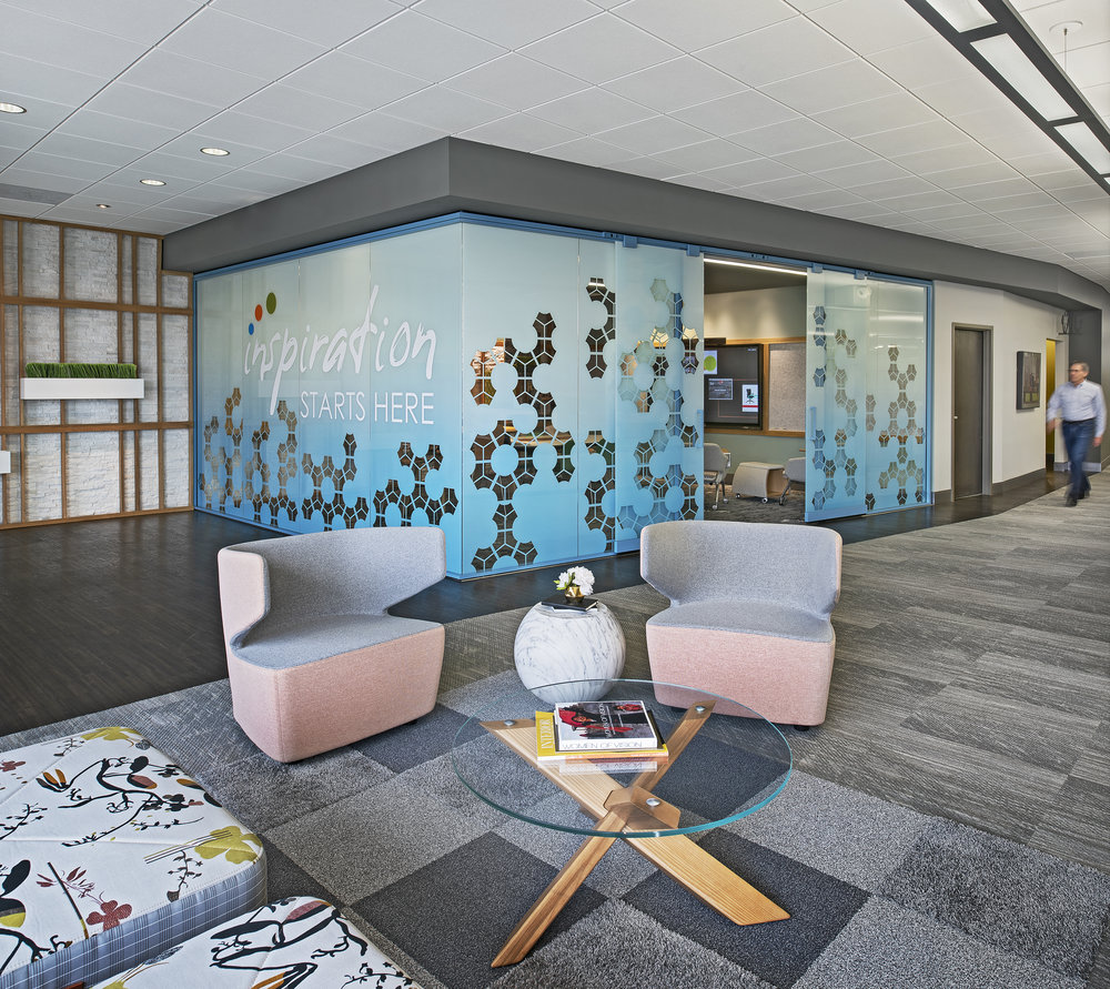 We realized that our often unused waiting area had tremendous potential as an additional conference room. We reconfigured our waiting area and added a full enclosed meeting space complete with Bluescape software.