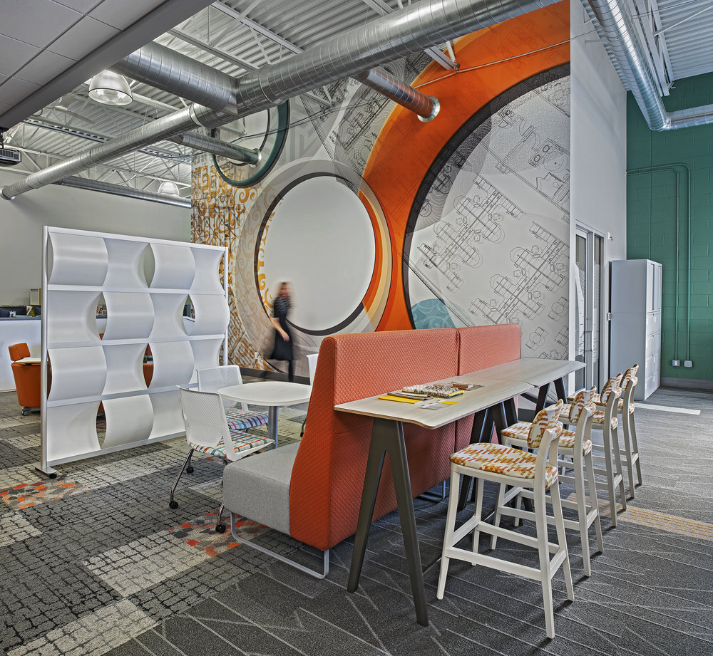 More seating options make our presentation area a perfect fit for large groups or company-wide meetings. Updated carpeting and paint compliment the custom wall graphic.