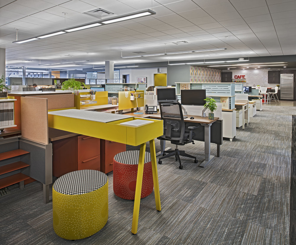 Updated workstations create a completely different vibe for the entire space. Our team is able to better collaborate on mutual projects with the lower height of the panels. The bright colors make the space warm and inviting and open while the dark wood and high panels created barriers that inhibited creativity and collaboration.