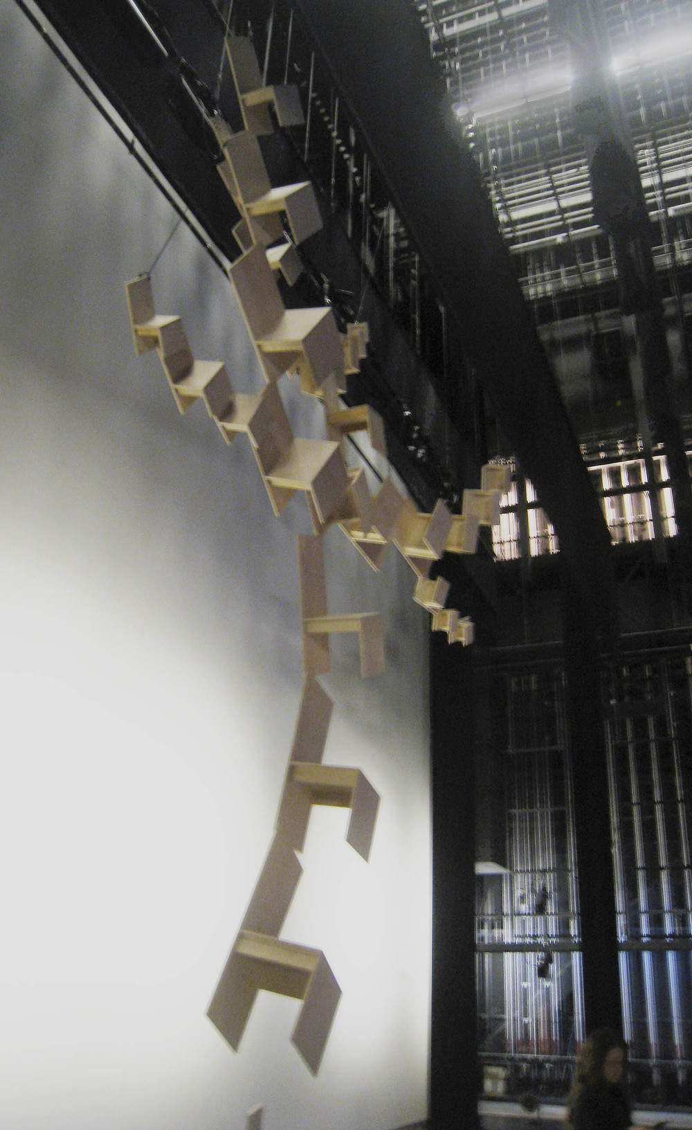 Backstage at the August Wilson Center, hanging the set-piece with airline cable.