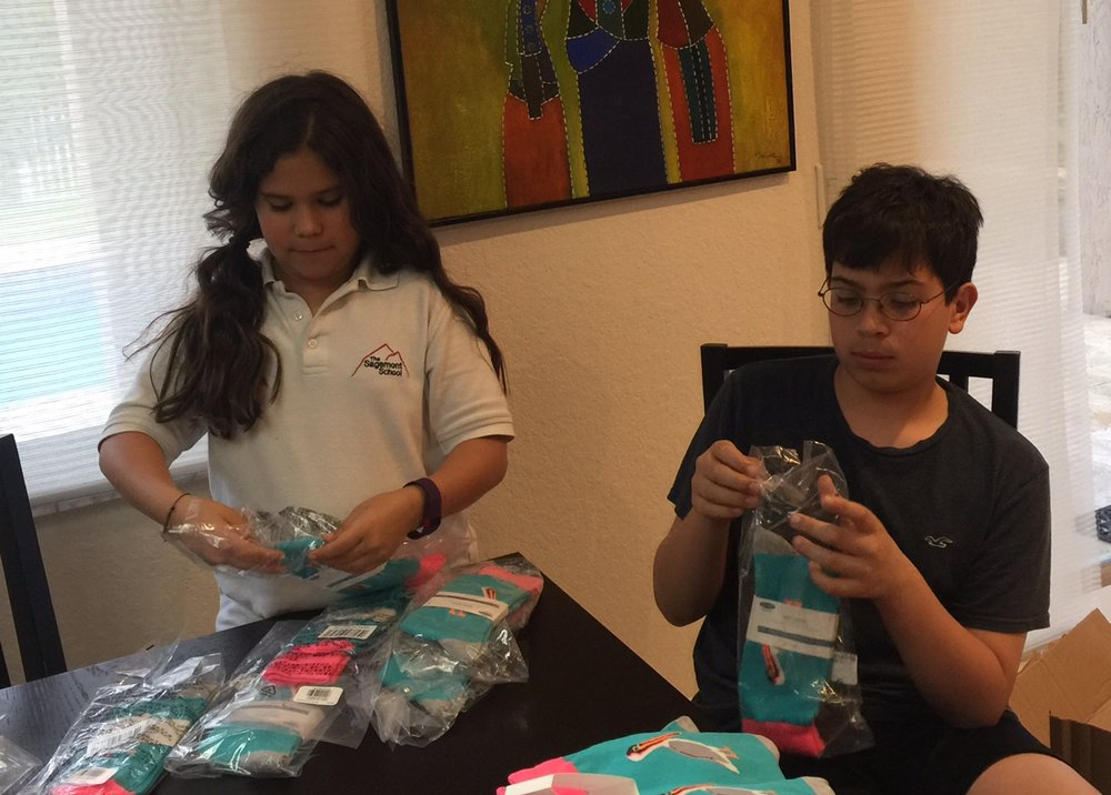 Oskar and Erika getting their pelican socks ready to sell!