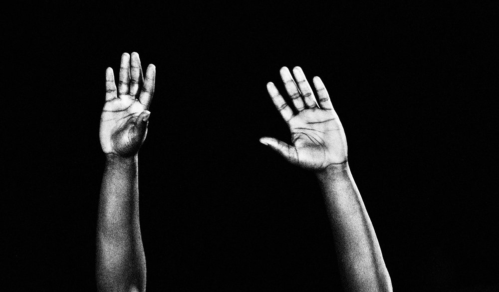 "Photo adopted from  this WIRED article :      A man yells, ""Hands up, don't shoot,"" in Ferguson, Missouri, while protesting the death of Michael Brown in August 2014."