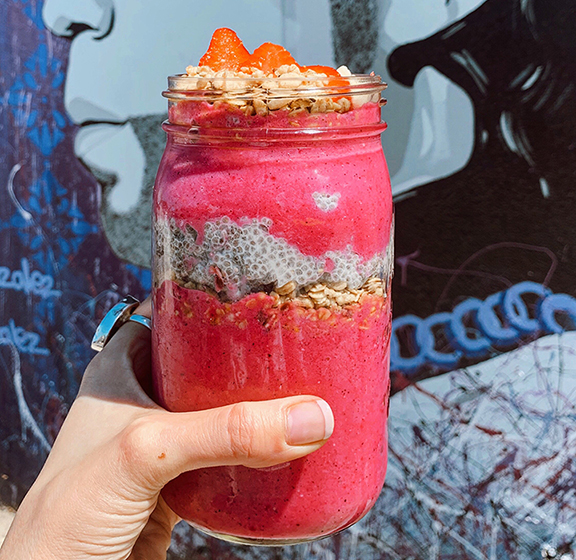 Pitaya Chia Cup from  The Juice Parlor   Smoothie Mix: Pitaya, Coconut Milk, Chia Pudding, Banana, Strawberry, Pineapple Toppings: Strawberry, Banana, Hemp Granola