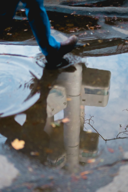zizkov tv tower prague puddle reflection street photography