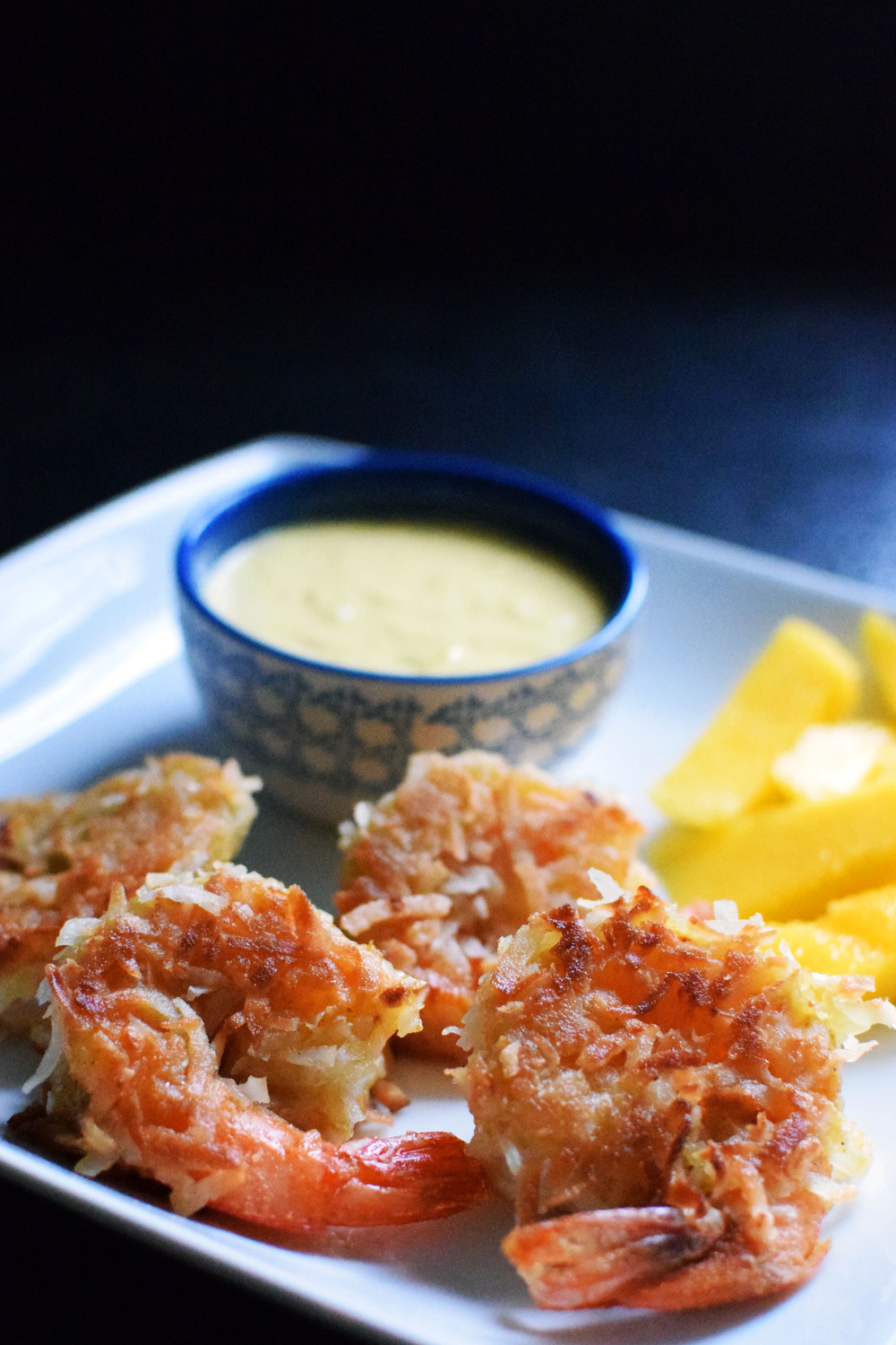 This Coconut Shrimp waith Mango Dipping Sauce is crunchy, sweet, and perfect for summer! Healthy and lightly cooked in coconut oil - not deep fried! | themillennialmenu.com