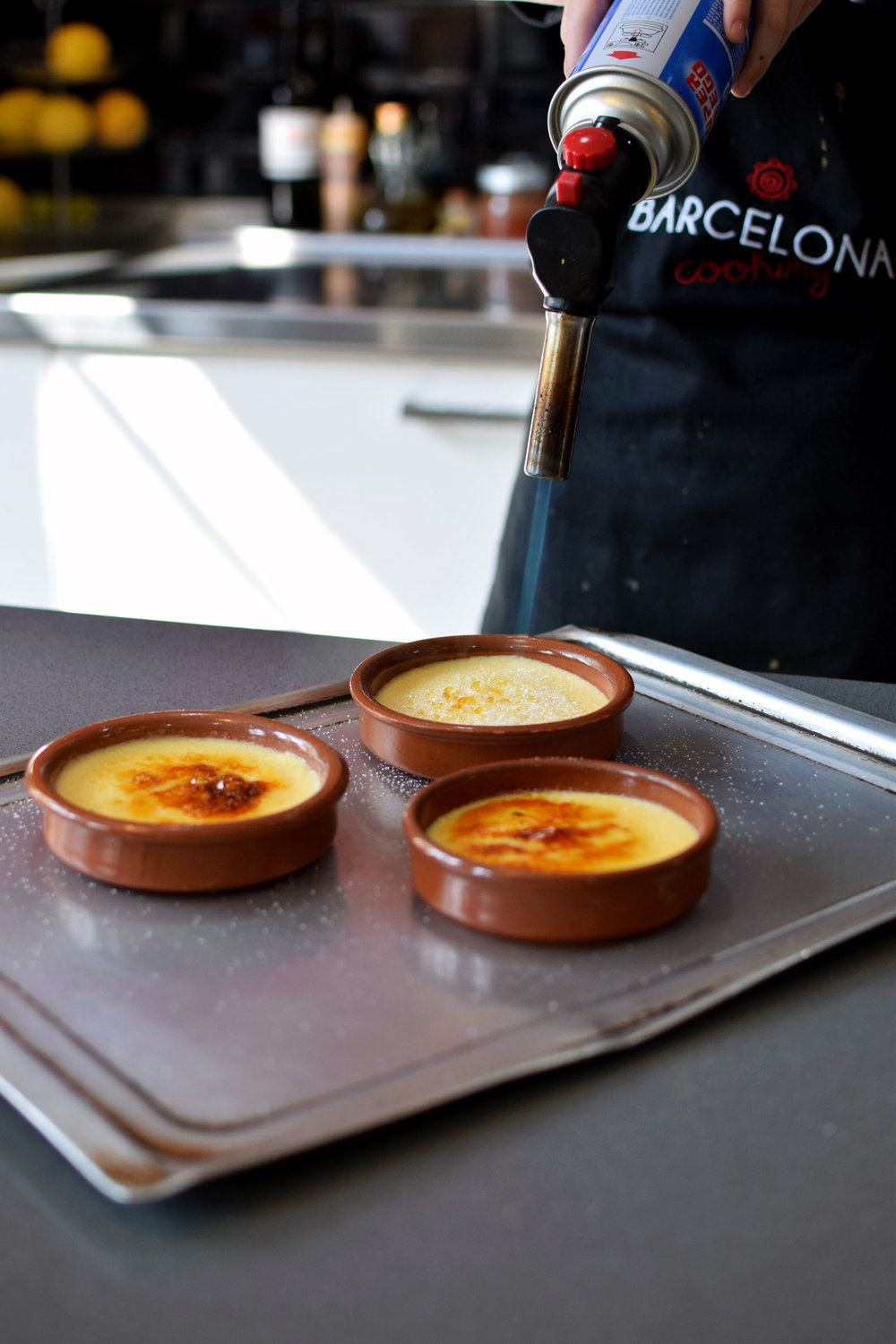 crema catalana in action at  barcelona cooking .