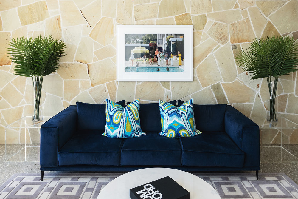 aston_milan_living_room_palm_springs_style_navy_sofa.jpg