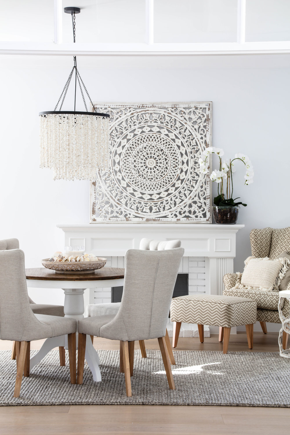 Pictured: Darby table, Xavier dining chair, Kingston occassional chair and ottoman, Uzma wall art.