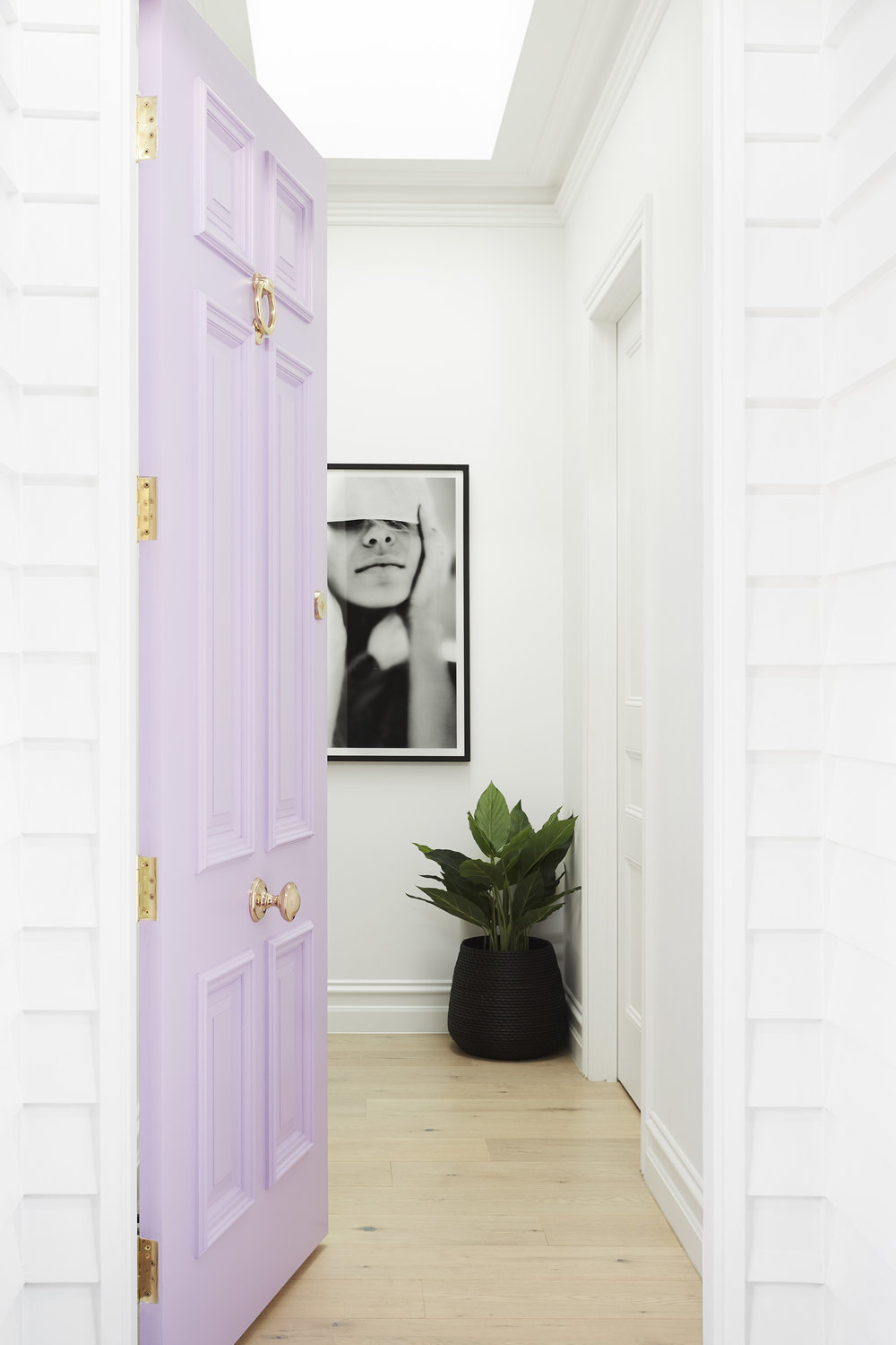 "LILAC DOOR - ""We had a lot of fun with the lilac front door,"" says Julia. ""It's in the shade 'Lavendula' by Taubmans and is utterly divine. The brass hardware from The Door Store takes it to the next level and sets the theme for the rest of the house."""