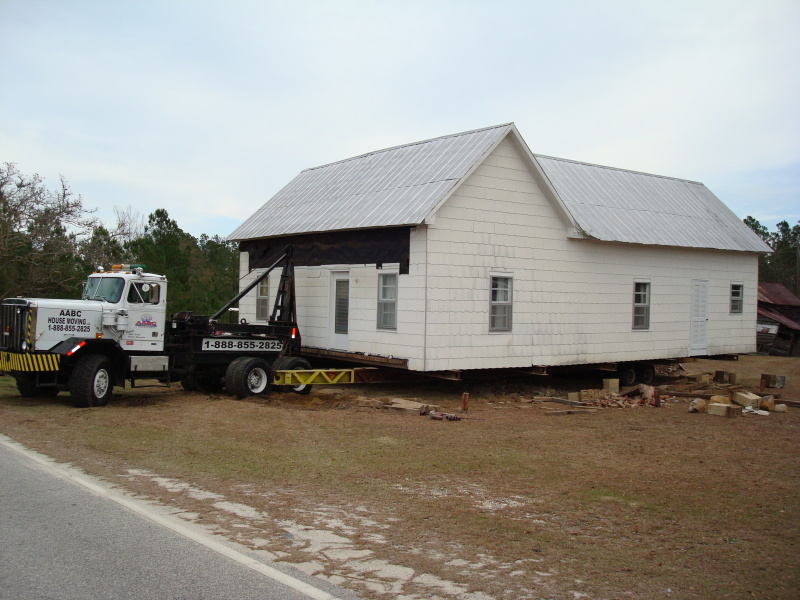 This 100 year old house has been lifted, loaded, and pulled to the road. It is ready for its journey!