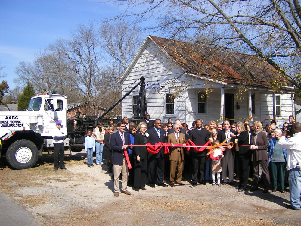 A ribbon-cutting ceremony commemorated the moving of the Bonds Conway house.