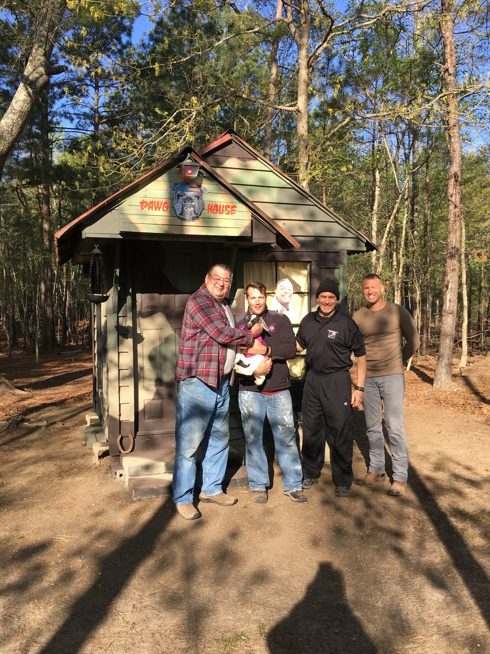 Operation Vet Fit members outside their newly renovated 2 person cabin with AC and bunks