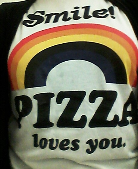 Dee Machado our Dough Master reminds you that Pizza Loves you all so you may as well smile!.