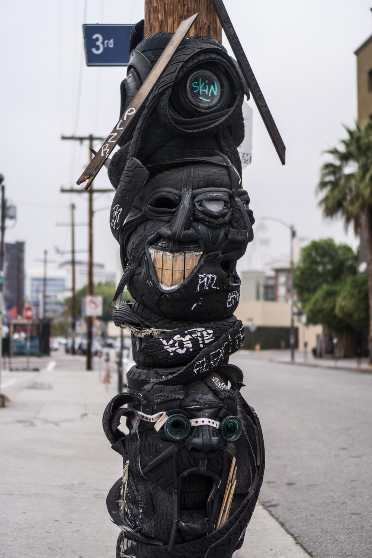 Tire art on a phone pole
